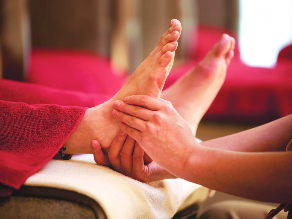 Woman receiving foot massage at Kenko Wellness