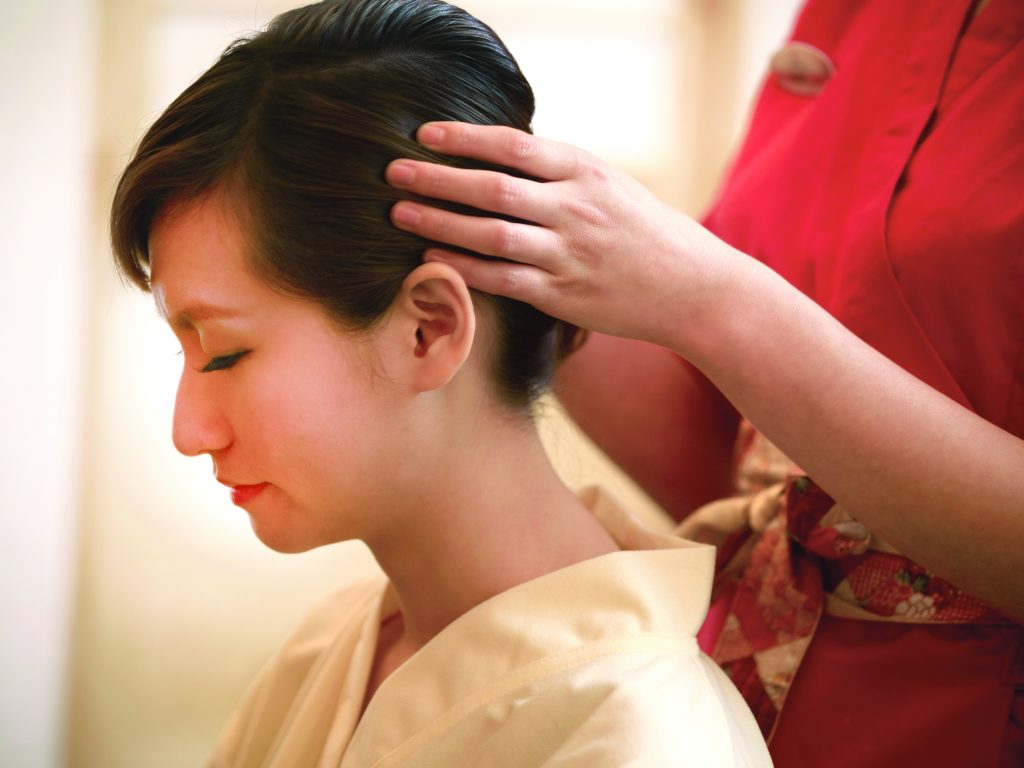 Woman receiving head massage at Kenko Wellness