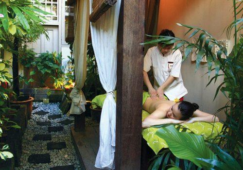Woman receiving full body massage at Kenko Wellness